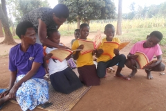 Children-in-Lwangoli-cluster-excited-after-receiing-the-home-schooling-study-materials.